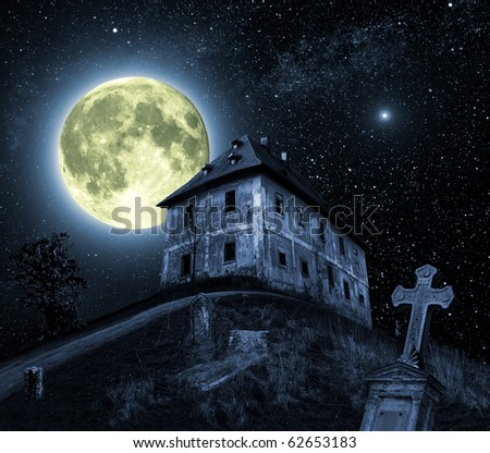 Night scene with full moon and haunted house - stock photo