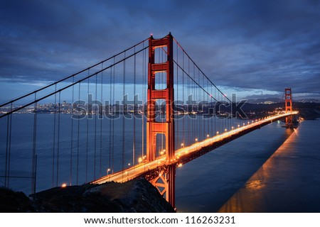 Night scene with Golden Gate Bridge and San Francisco lights - stock photo