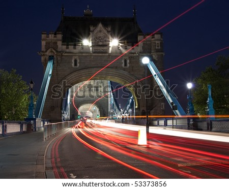 Night scene with traffic light trails in the Tower Bridge in London - stock photo