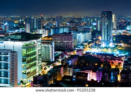 Night Scenery of Singapore in the colored night lighting - stock photo