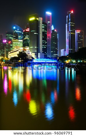 Night Scenery of Singapore's skyscrapers reflected in the water - stock photo