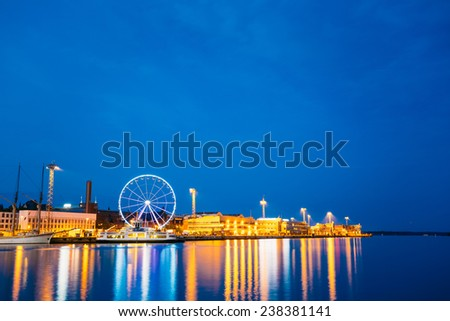 Night Scenery Panoramic View Of Embankment With Ferris Wheel In Helsinki, Finland - stock photo