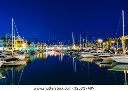 Night Scenery View Of Embankment, vessel In Benalmadena. Benalmadena is a town in Andalusia in Spain, 12 km west of Malaga, on the Costa del Sol. It caters for a large number of tourists. - stock photo