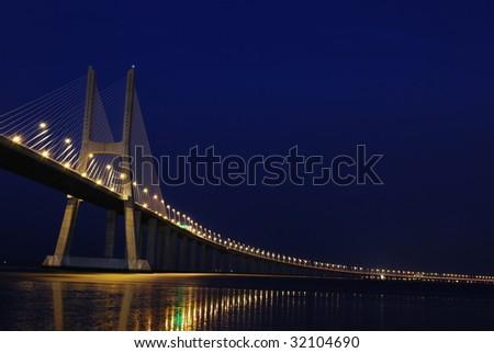 night shoot of Vasco da Gama Bridge in Lisbon, Portugal - stock photo
