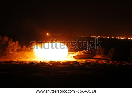 Night shooting of a Merkava main battle Tank. Part of training for the Armour corps. - stock photo