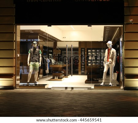 night shop window with men dressed mannequins - stock photo