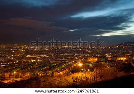 Night shot from Tehran skyline and illuminated buildings of the city, just after sunset. - stock photo