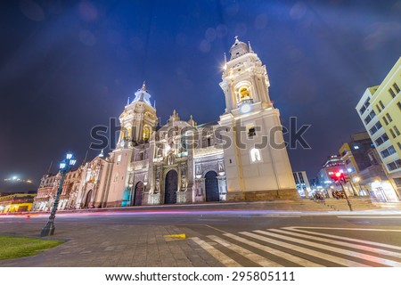 Night shot & Long exprouser of the cathedral church and the main square with Artificial ray of light and bokeh on top in order to make Cathedral standout, Lima, Peru - stock photo