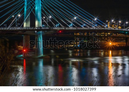 Night shot of a bridge spanning the Willamette river in Portland Oregon