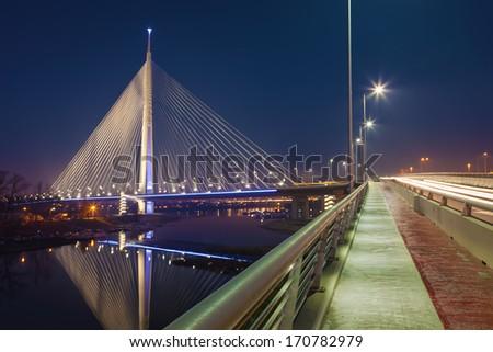 Night shot of Ada bridge on Sava river in Belgrade - stock photo