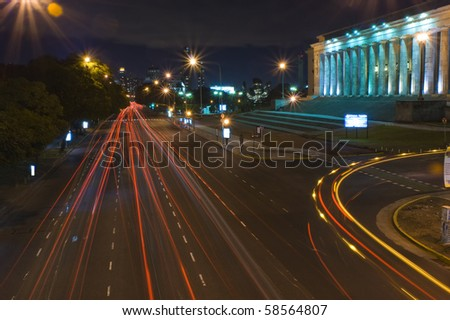 Night shot of city traffic in Buenos Aires city. - stock photo
