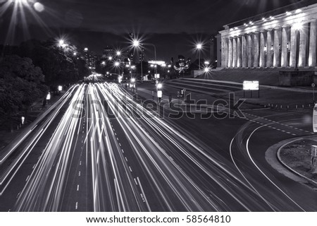 Night shot of city traffic in Buenos Aires city. Black and white. - stock photo