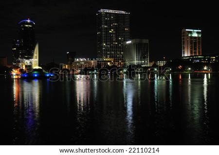 Night shot of Downtown Orlando, Florida facing north-west corner of Lake Eola - stock photo