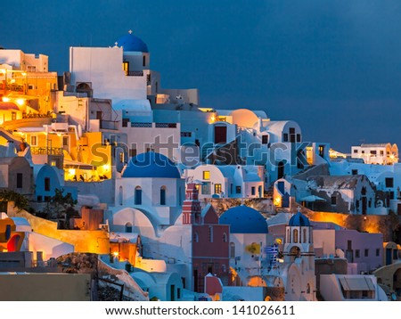 Night shot of houses and churches at Oia Santorini Greece - stock photo