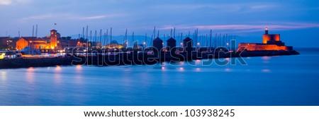 Night shot of Mandraki harbour Rhodes Greece. - stock photo
