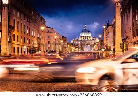 Night shot of St. Peter's Basilica  in Rome with road - stock photo