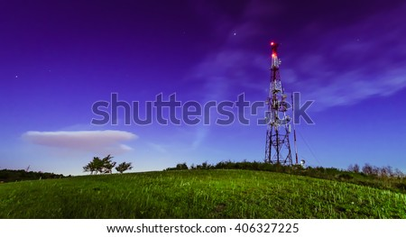 Night shot of the antenna tower on the top of the hill - stock photo