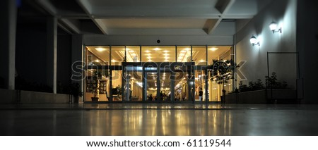 Night shot of the entrance and facade to a luxury european hotel. - stock photo