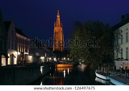 Night Shot of the famous Church of Our Lady in Bruges, Belgium. - stock photo