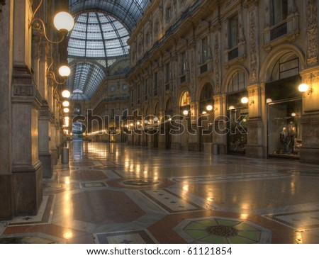 night shot of the hall of the landmark arcade or covered luxury shopping mall, Galleria Vittorio Emanuele II in Milan, Italy - stock photo