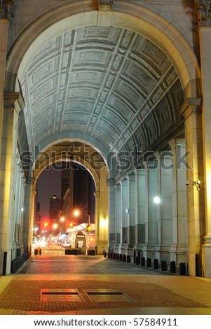 Night shot of the passage way through the center of the Municipal building.