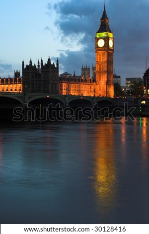 Night shot over the Thames of the Houses of Parliament - stock photo