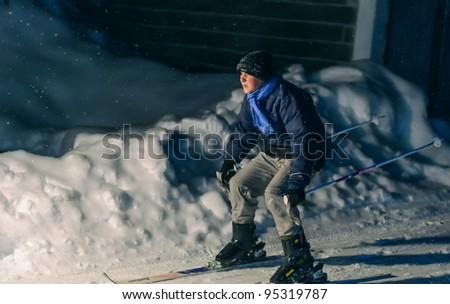 Night skiing - stock photo