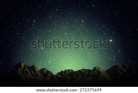 Night sky above rocky mountains background - stock photo