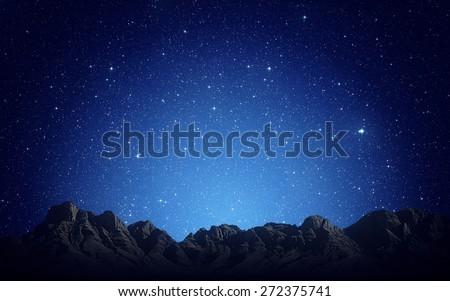 Night sky above rocky mountains background - stock photo