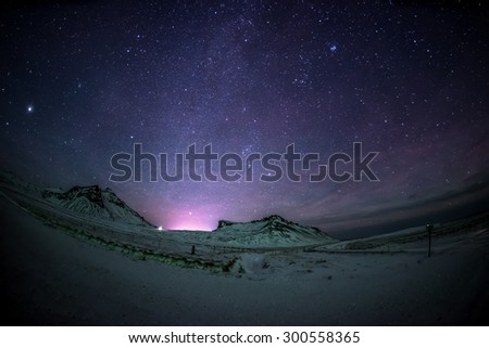 Night sky and Milky Way in the mountains - stock photo