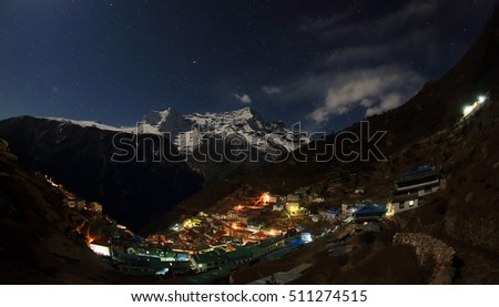 Night sky and stars passing by behind mountain Kongde Ri, Namche Bazaar village. Nepal