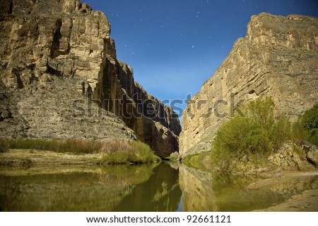 Night Sky behind Santa Elena Canyon on the Rio Grande river, border of United States and Mexico. Big Bend National Park, Texas, United States. - stock photo