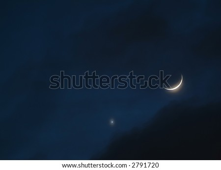 Night sky with crescent moon and venus - stock photo