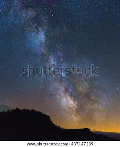 Night sky with Milky Way and Galaxy above the horizon. - stock photo