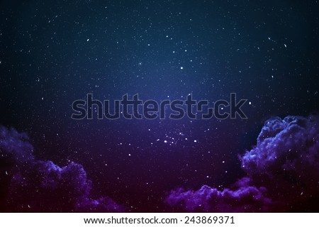 Night sky with stars and clouds shot. - stock photo