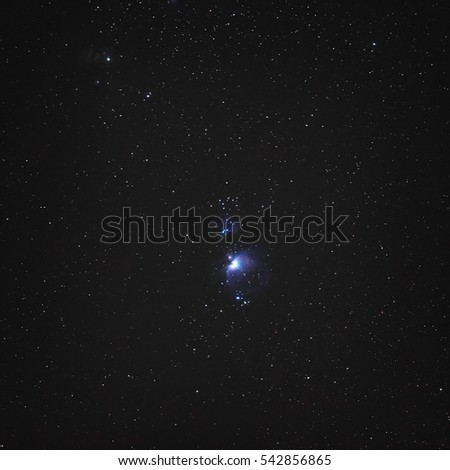 Night sky with stars and the central part of the constellation Orion. Nebula M42. North hemisphere.