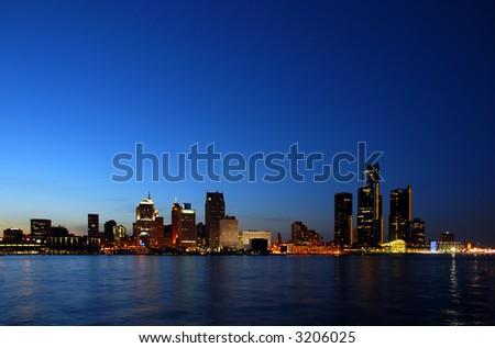 Night skyline and coastline - stock photo