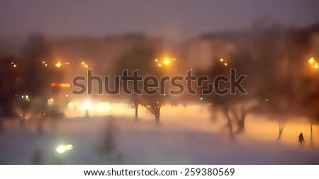 night snowstorm, blurred bokeh photo - stock photo