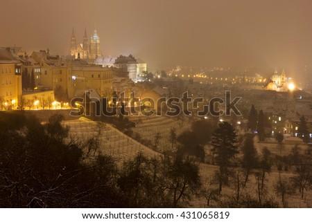 Night snowy foggy Prague City with gothic Castle, Czech republic - stock photo
