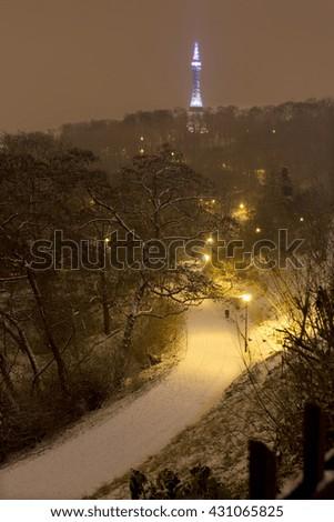Night snowy foggy Prague Watchtower on Hill Petrin, Czech republic - stock photo