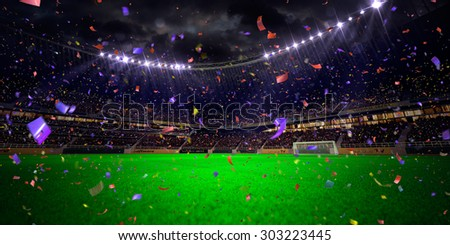 Night stadium arena soccer field championship win! Confetti and tinsel. Blue toning