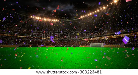 Night stadium arena soccer field championship win! Confetti and tinsel . Yellow toning
