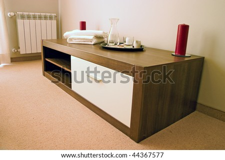 Night stand with two red candles, towel and glasses. - stock photo