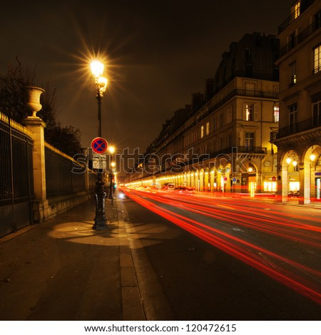 night street of a street in Paris with light trails - stock photo