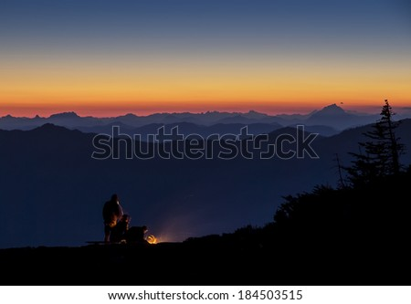 NIght time camping on a mountain top with a beautiful sunset view - stock photo
