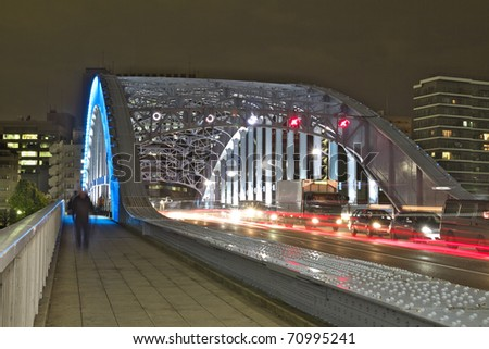 "night time colorful reflection of ""��Eitai"" Bridge illumination in waters of ""Sumida"" river of Tokyo , Japan"