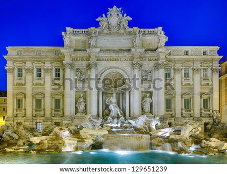 Night time floodlit details of statues in Trevi fountain in Rome Italy - stock photo