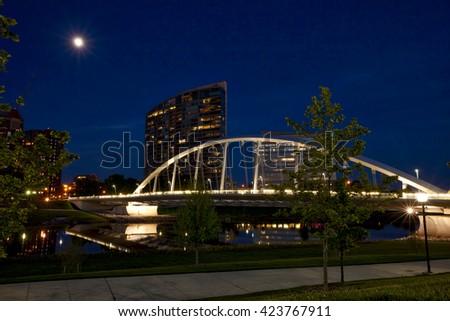 Night time glow of the Main Street Bridge in Columbus, Ohio - stock photo