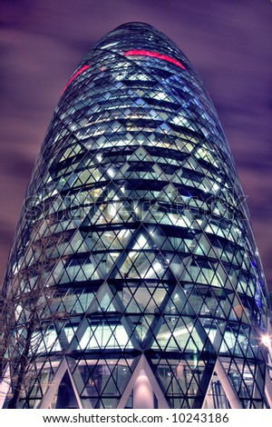 Night-time HDR view of The Gherkin in the City of London - stock photo