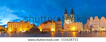 Night time illuminations of the magical Old Town Square in Prague, visible are Kinsky Palace and the fairytale gothic towers of the Church of Our Lady Tyn (1365). - stock photo